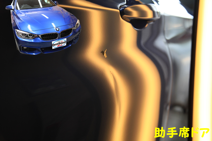 BMW助手席ドアのへこみ、修理前の写真