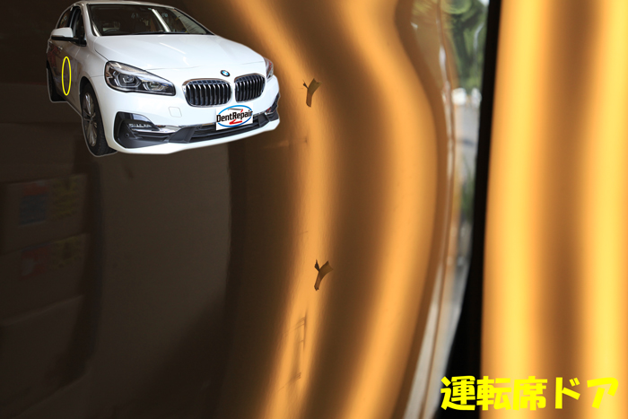 218i運転席ドアのへこみ、修理前の写真